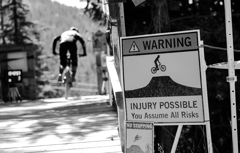 For most mountain bikers, injury is actually probable on the legendary A-Line trail, but the pros and Whistler Mountain Bike Park regulars make it all look easy.