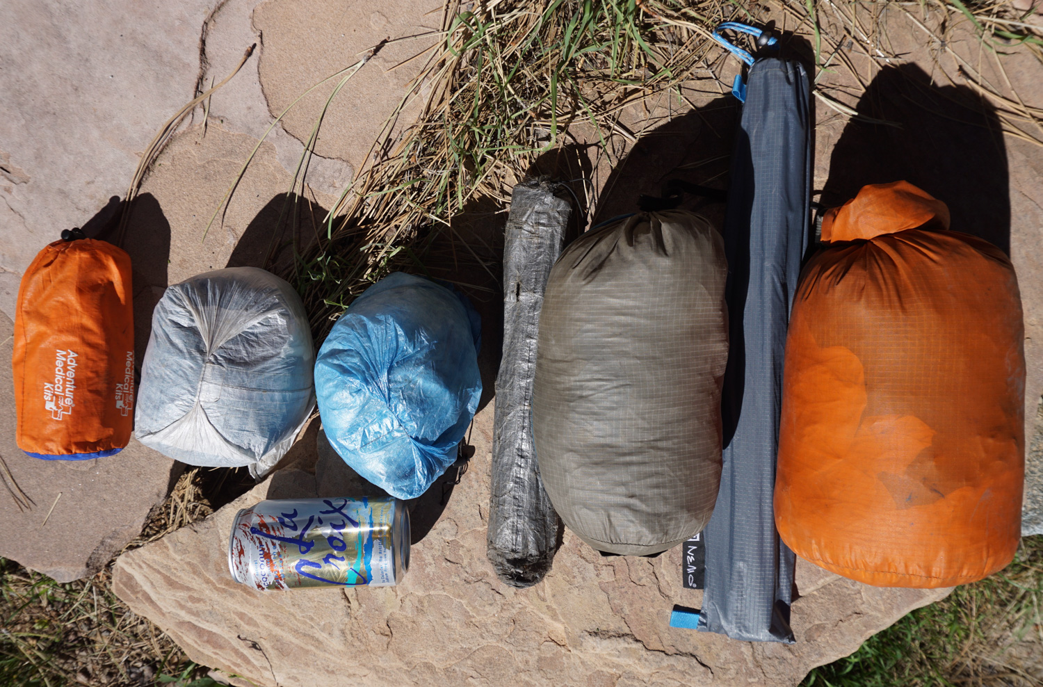 From left to right, SOL Emergency Bivy, Montbell U.L. Sleeping Bag Cover, ZPacks Hexamid Pocket Tarp, Black Diamond Beta Light tent with ZPacks poles, and Nemo Blaze 2P tent and poles.