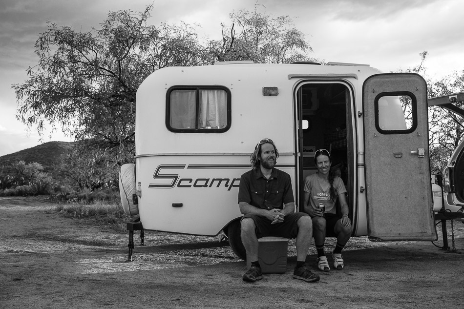 Scott, Eszter and the Scamp trailer they call home.